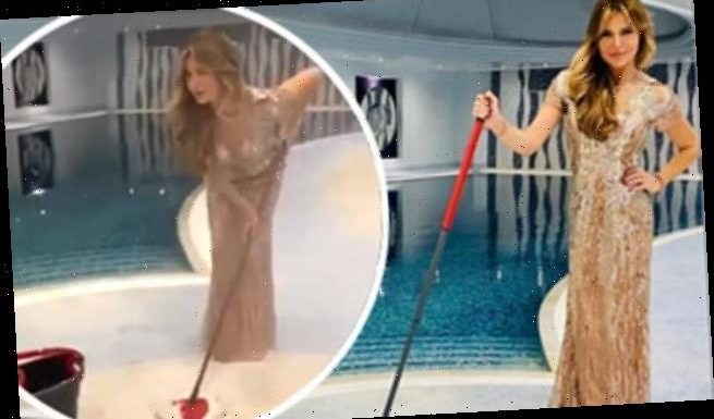 Lizzie Cundy scrubs her indoor swimming pool in a ballgown