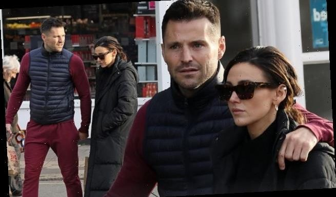 Michelle Keegan and Mark Wright look pensive as they head to the shops