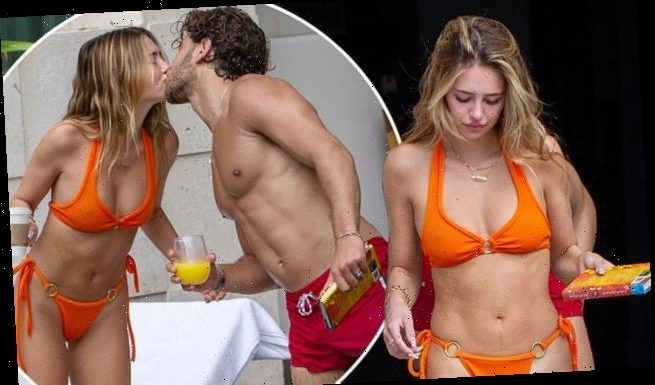 Delilah Belle Hamlin wows in a orange bikini during pool day with Eyal