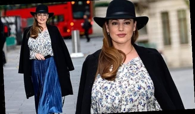 Kelly Brook showcases her slimmed down figure as she arrives for work