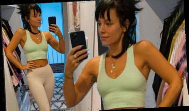 Lily Allen shows off her toned abs in a green crop top and leggings