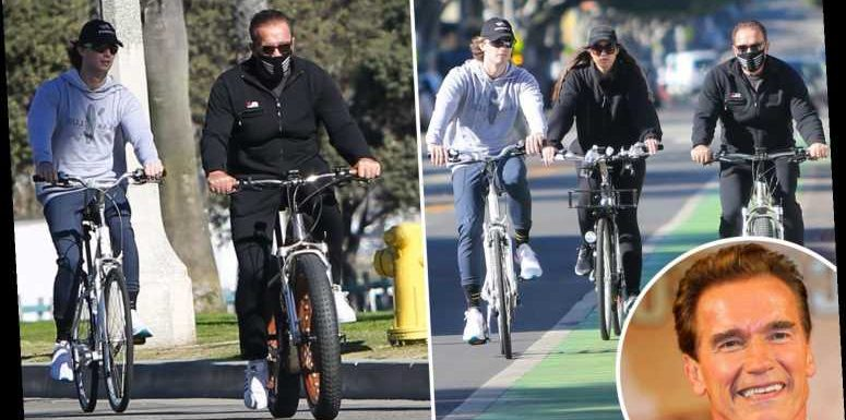 Arnold Schwarzenegger rides a bike with his kids Patrick and Christina just a month after the actor's heart surgery