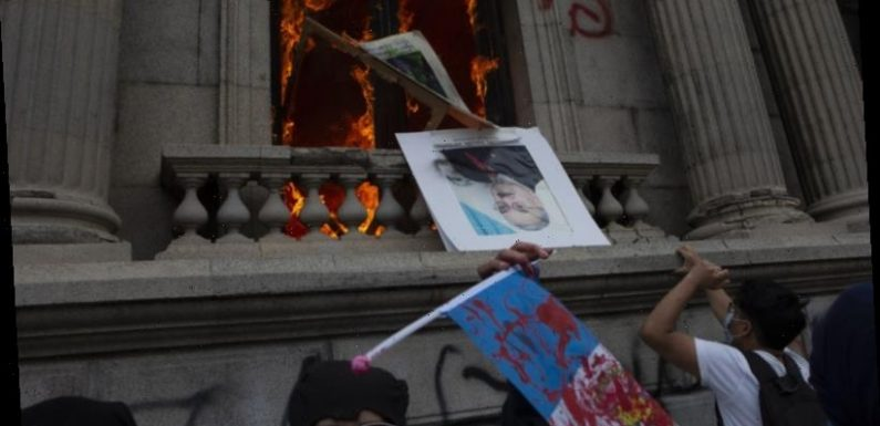 Protesters in Guatemala set fire to Congress building