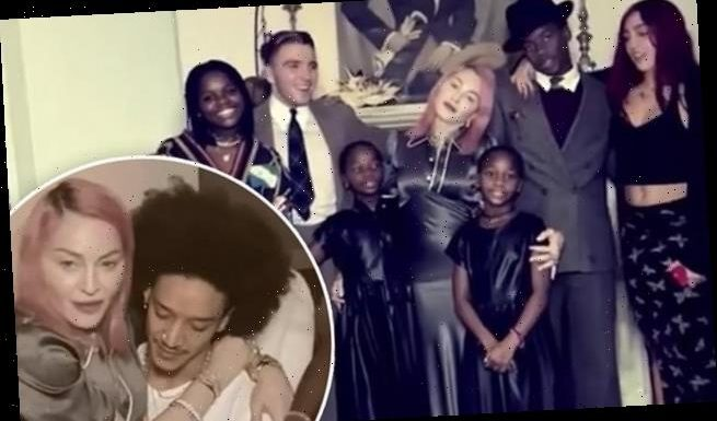Madonna gives fans a rare look at the whole family in holiday photos