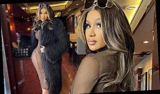 Cardi B displays her stunning curves in a completely sheer dress