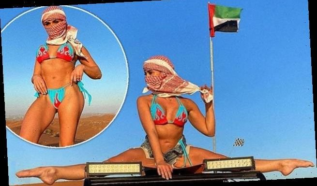 Gabby Allen wows in flame bikini as she does the SPLITS on BUGGY