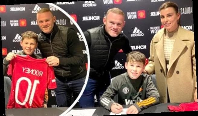 Wayne and Coleen Rooney pose with son Kai, 11, as he signs with Man U