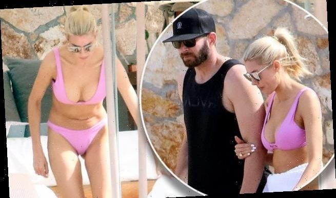 Heather Rae Young frolics in a hot pink bikini in Cabo with Tarek