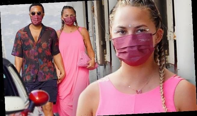 Chrissy Teigen glows in a pink dress while shopping with John Legend