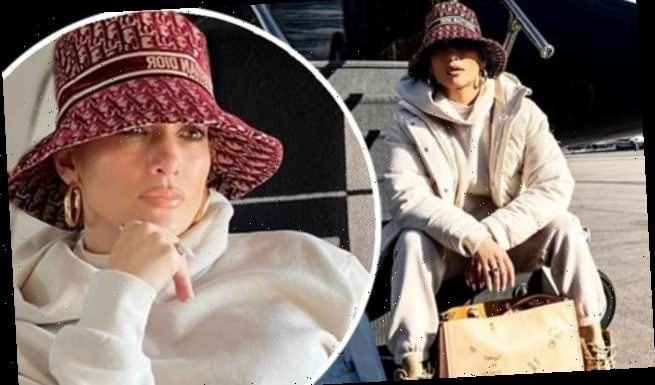 JLo dons Dior hat as she boards private jet to NYC for New Year's