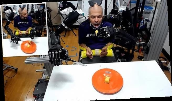 Quadriplegic man controls robotic arms with his mind to feed himself