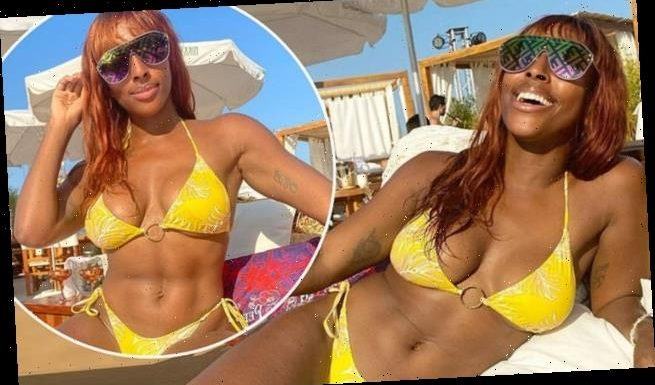 Alexandra Burke displays her phenomenal frame in a yellow bikini