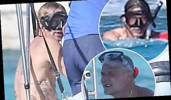 Brad Pitt shows off muscled physique snorkeling in Turks and Caicos