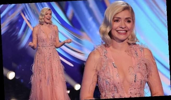 Holly Willoughby exudes glamour in a pink sheer dress for DOI