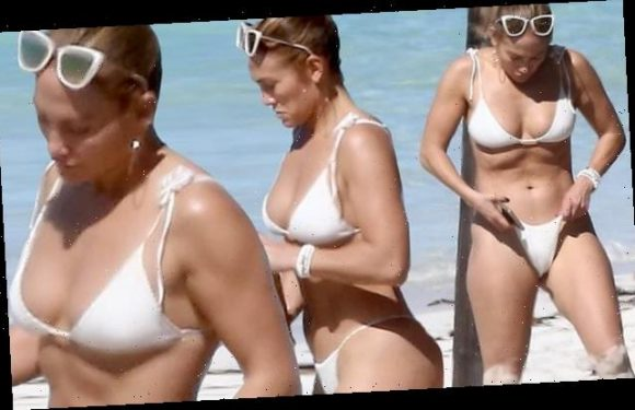 Jennifer Lopez famous derriere on display in a tiny white bikini