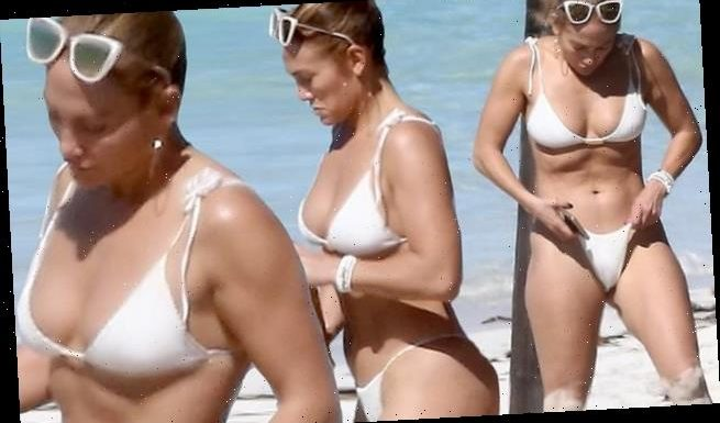 Jennifer Lopez famous derriere on display in a tiny white bikini