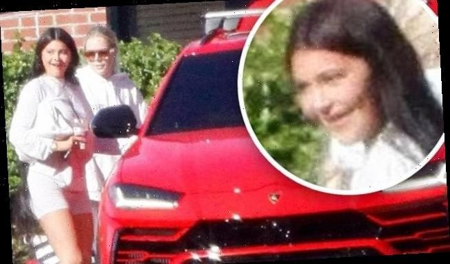 Kylie Jenner pulls up to her private jet in a red Lamborghini in LA