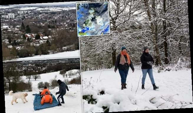 Met Office warns of up to a FOOT more snow and floods