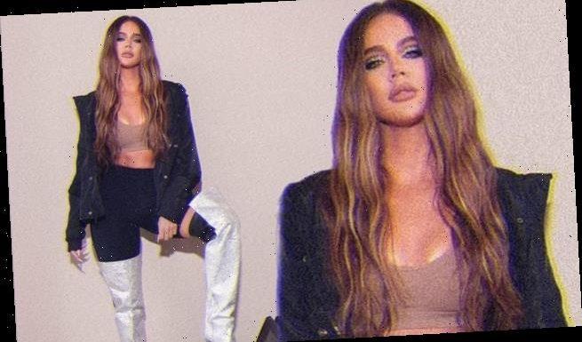 Khloe Kardashian showcases her washboard abs in a nude crop top