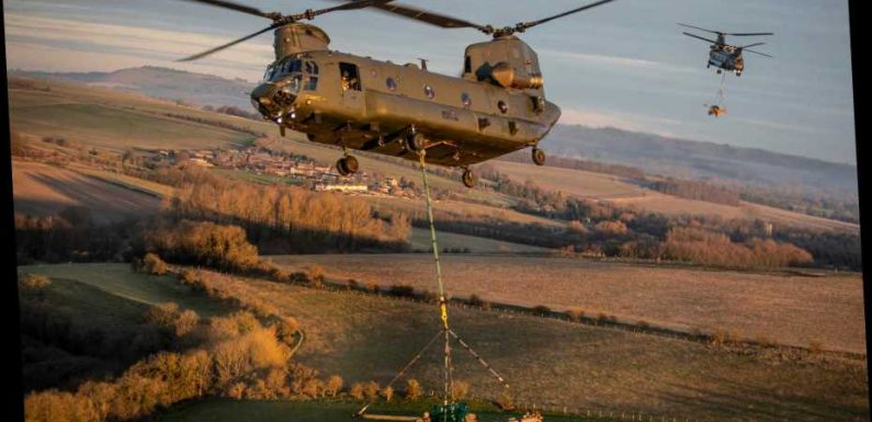 RAF Chinook sinks in mud after rookie pilots forced to make emergency landing in bog