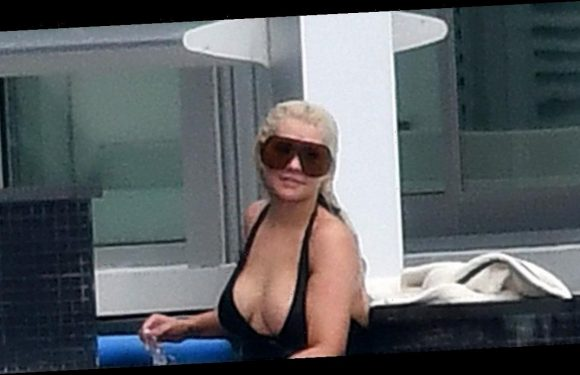 Christina Aguilera shows off eye-popping cleavage in sizzling swimsuit display