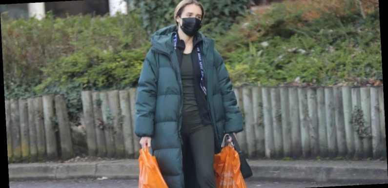 Megan McKenna wraps up warm in padded winter coat as she does food shop in Essex
