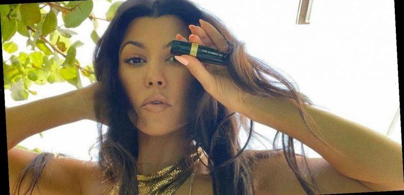 Kourtney Kardashian risks wardrobe malfunction while wearing tiny gold bikini