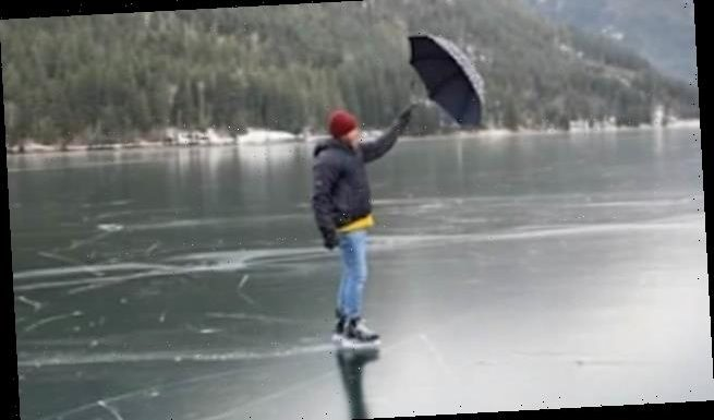 Skater uses an umbrella to glide Mary Poppins-style