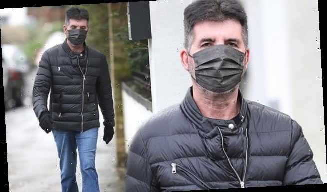 Simon Cowell shows his 20lbs weight loss while on a stroll in London