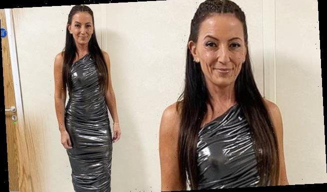 Davina McCall, 53, flaunts her physique in a PVC metallic dress