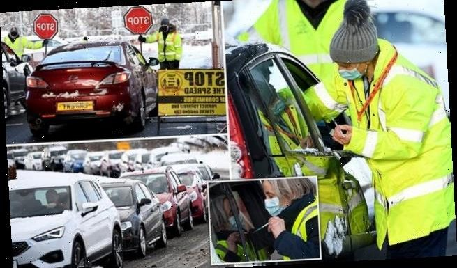 Motorists go to drive-through vaccination centres to get Covid-19 jab