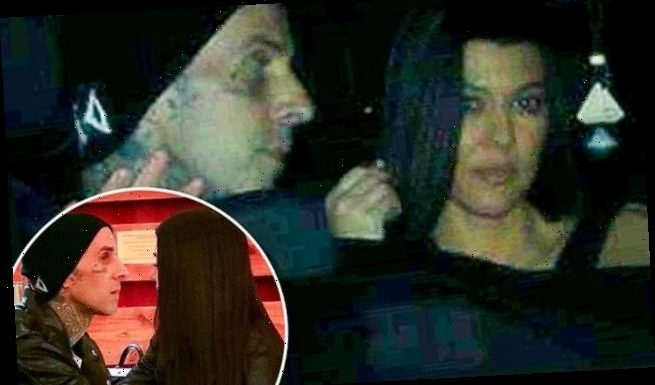 Kourtney and Travis hold hands across table on dinner date