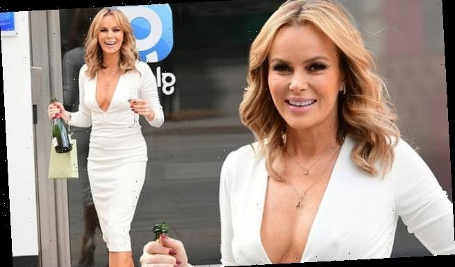 Amanda Holden braves the cold on her 50th birthday in white dress