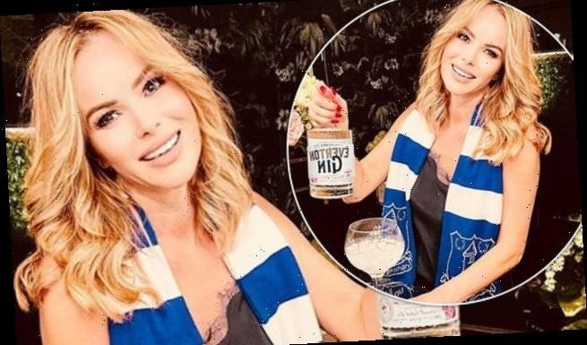 Amanda Holden poses in an Everton FC scarf as she celebrates their win