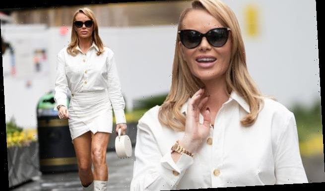 Amanda Holden puts on a leggy display in a white mini skirt and blouse