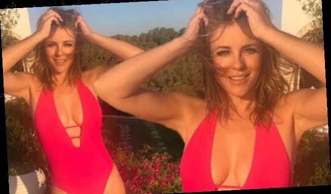 Elizabeth Hurley shows off her curves in plunging red swimsuit