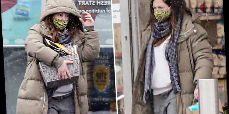 EastEnders' Lacey Turner spotted for the first time since giving birth to her second baby as she shops in London