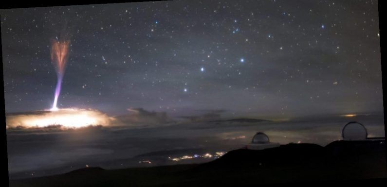 A stunning photo shows both red-sprite and blue-jet lightning in the skies above Hawaii