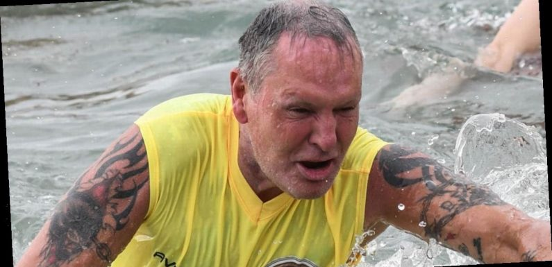 Paul Gascoigne struggles as he wades through deep water in Italy's I'm A Celeb