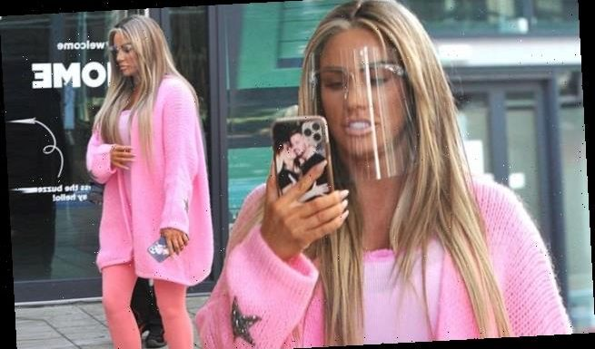 Katie Price looks stylish in an all-pink ensemble and a face shield