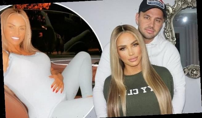 Katie Price poses with Carl Woods after appearing to confirm pregnancy