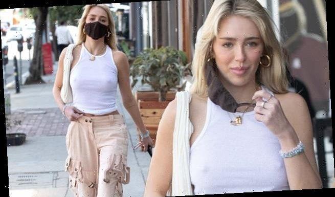 Delilah Hamlin goes braless in a white cropped vest in LA