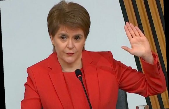 Nicola Sturgeon says sorry to women 'failed' as she fights for her career in crunch committee clash