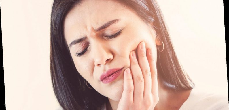 Here's Why Your Teeth Are Sensitive (And What To Do About It)