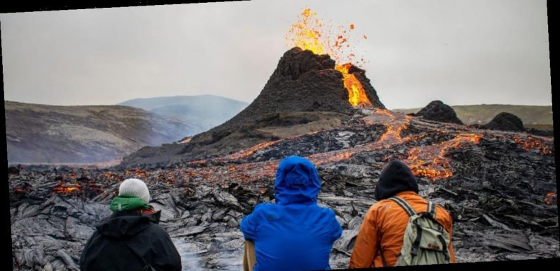 Photos show crowds gathering in Iceland to witness long-dormant volcano eruption