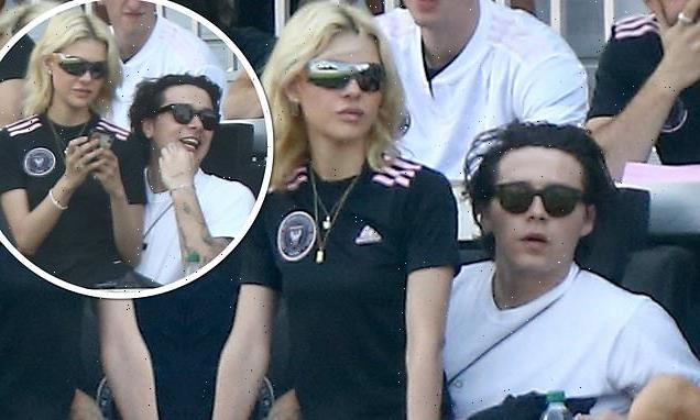 Brooklyn Beckham's fiancée Nicola Peltz sits on his lap during match
