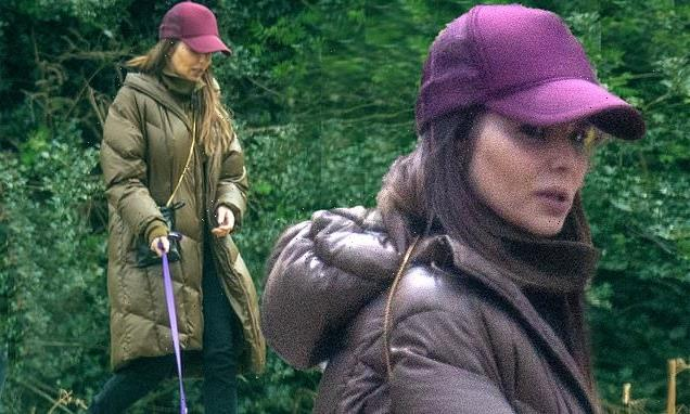 Cheryl takes her new dog out for a walk during rare sighting