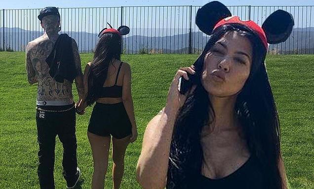 Kourtney Kardashian holds hands with beau Travis Barker on Instagram