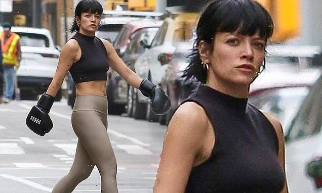 Lily Allen flaunts her toned midriff in crop top and leggings in NYC