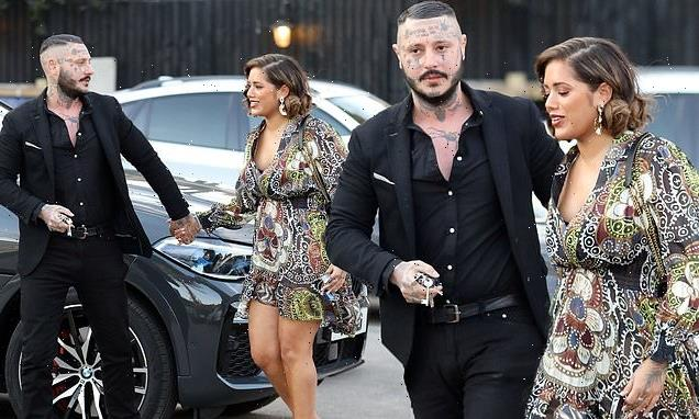 Malin Andersson holds hands with tattooed-faced Michael James